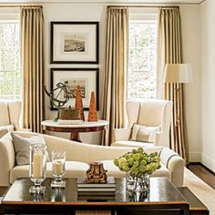 Living Room with Antiques:  As the budget allows, invest in one fine antique per room.  In this living room, the round French marble-topped gueridon table becomes a focal point of the space.