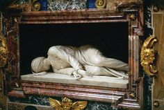 Rome Photos at Frommer's - Stefano Maderno's statue of Santa Cecilia which portrays the saint as she was found, lying on one side, when her tomb, which was moved to the church of Santa Cecilia in Trastevere in the 9th century, was reopened in 1599