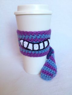 Interesting version -- Cheshire Cat inspired coffee cup cozy from Alice in by YOmomknits