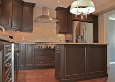 chocolate dark brown stained kitchen cabinets | Stunning Dark Stain Cabinets With Stone Countertops | Mylen