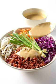 Thai Buddha Bowl with Peanut Sauce - this healthy recipe with red rice with a rainbow of veggies is gluten free, vegan and clean eating.