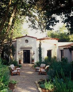 Italianate mediterranean exterior...love the stucco and the beautiful garden and courtyard...