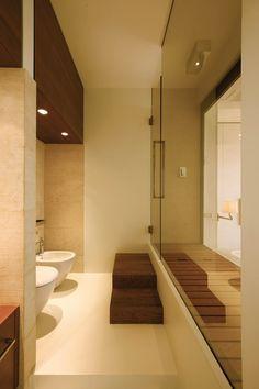 shower separating bathroom and bedroom