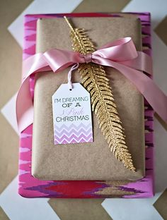 pink & gold feather. Love this ikat wrapping paper.