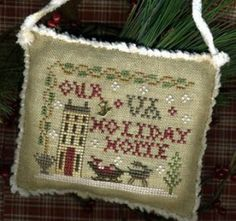 """""""Your State Holiday Home (Sampler Ornament 2013) is the title of this Christmas ornament cross stitch pattern from Homespun Elegance where y..."""