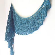 Current by Kephren Pritchett. Knit this crescent shaped shawl with its undulating lace pattern in elann Soft Embrace 4-Ply 100% Superwash Wool.