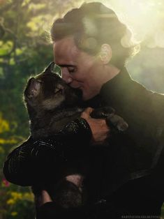 Tom Hiddleston with a puppy.
