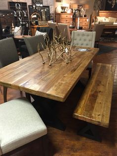 Wesling Table. Industrial metal bases are topped with rich, thick slabs of sustainable mango wood. Matching coffee table, end table, & sofa table. Ashley Furniture
