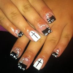 Black tips with white leopard spots and one white nail with cross