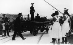 Unloading relief supplies in Jersey in the Second World War | St John Ambulance members wearing brassards supervise the arrival of a horse-drawn dray at St Helier harbour, while British Red Cross nurses look on, 1945.  The volunteers were unloading relief for people in Jersey, sent on the Red Cross ship SS Vega during the German occupation.