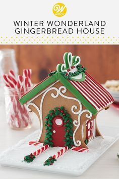 It is great fun for the DIY decorator, as Wilton provides the ideas, techniques and ingredients to create this gingerbread house upgrade. Decorate this festive house kit at your next girl's night out or family party. Gingerbread House Designs, Gingerbread House Parties, Christmas Gingerbread House, Christmas Sweets, Christmas Candy, Christmas Baking, Christmas Cookies, Gingerbread Houses, Italian Christmas