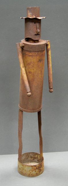 """Folk art hand made tin man wearing top hat, circa 1930.  34"""" tall.  Would look great in the garden"""