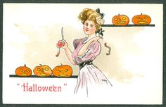 Apple Peel Charm: Sometimes the peel was tossed to see what letter it would form, this being the first letter of your future lover's name. Embossed Leubrie & Elkus Halloween Postcard