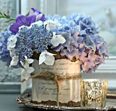 Transform tin cans into unique vases with burlap ribbon & old ledger paper.