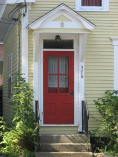 yellow houses with red doors | yellow house black shutters red