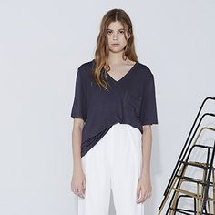 The Fifth Label   V-Neck Slouchy Charcoal T-shirt The Walk In The Sky T-Shirt is a relaxed fit t-shirt with a deep v-neckline and short sleeves in a lightweight stretch fabric. Designed in Australia. Available in washed black and white. Designer carried by Nasty Gal.  Colour: Washed Black and White Fabric: 95% viscose / 5% elastane Model is wearing size small.  This item is available in multiple sizes, please contact for sizing availability.   Love the item but not the price, make an offer…