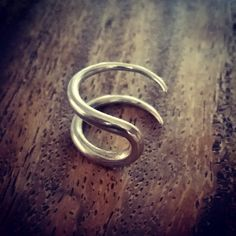 Handmade silver piercing for two adjacent holes. More info: http://diligencejewellery.ecwid.com/  #piercing #lobepiercing #diligencejewellery #silver #piercingjewellery