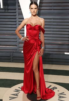 All hail lady in red Alessandra Ambrosio who stole all the stares at the Vanity Fair after party in an asymmetric corset dress.