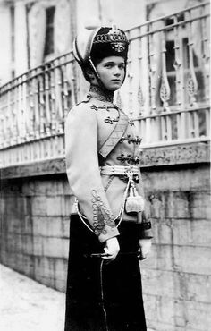 grand duchess olga nikolaevna poses in her regimental uniform outside the alexander palace.