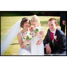 The Bride and Groom with their flower girl on a beautiful day