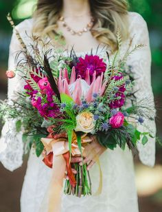 love this bohemian bouquet of protea, thistle and dahlias for a boho capri bride - minus the bright colours, and about 1/3rd the size!