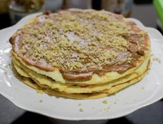 Chilean Thousand Layers Cake is the most traditional cake in Chile, layers of thin crispy dough almost cookie like and dulce de leche. Chilean Desserts, Chilean Recipes, Chilean Food, Torta Chilena Recipe, Thousand Layer Cake, Traditional Cakes, Food Names, Cake Fillings, Mille Feuille