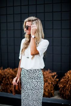 Printed pencil skirt paired with white and cognac.