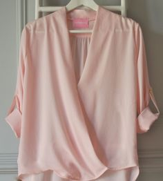 pink long sleeve loose shirt.