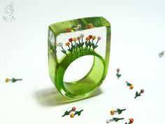 Tulips from Amsterdam – springlike flower ring with colourful plastic mini-tulips on a green ring made of resin by GeschmeideUnterTeck on Etsy https://www.etsy.com/listing/130948916/tulips-from-amsterdam-springlike-flower