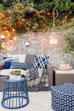 Small outdoor area with string lights and mix of throw pillows