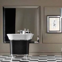 Art deco interior design style, white and black tiles, large mirror and unique sink cabinet