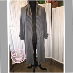 """Gray Sweater Duster This cardigan is dress length.  It is a medium color of gray.  Notice the interesting knitting around the neck and down the front.  There is one single hook and eye closure that would fall right below the natural waist. This sweater has been worn a few times, but remains in very good condition.  I did find one place where there is a small defect approximately 1"""" long.  Very faint.  I would refer to this as a sweater duster. Apt. 9 Sweaters Cardigans"""