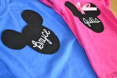 Minnie Mouse Party ~ Favors ~ DIY Mickey & Minnie Shirts | Make template on construction paper (used a bowl & cup), use chalk to trace the templet on black felt. Write each of the kid's names in chalk and then trace them in white fabric paint. Use a lot of fabric glue to attach them to shirts. For Minnie: use safety pins to keep bows attached and then remove them before washing.