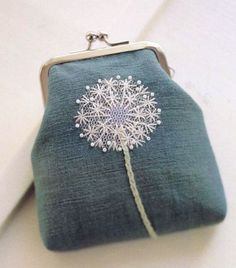 Embroidered Denim coin purse.