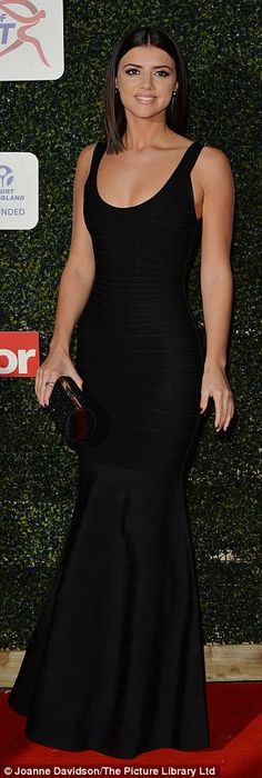 Glamorous: Lucy showed off her gym-honed figure in a black bodycon mermaid dress, which she teamed with a matching clutch bag