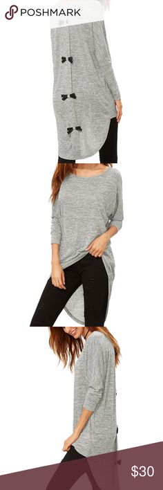 NWOT Grey Bow Back Top Brand new bow back top in a grey shade. Very cute with leggings or skinny jeans. So comfy but chic at the same time! Tops Tunics
