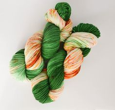 Colors: Emerald/Olive Green and Orange Speckles Fiber: 100% superwash merino wool Weight: DK Meters/Yards: 224m/246yds (100g skein) Suggested Needle Sizes: US Size 5 or 3.75mm (5.5 sts per inch according to yarn supplier) Suggested Hook Size: 7 or I Hook Hand dyed with acid dyes