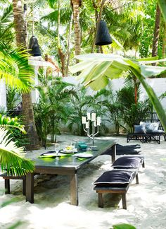 An outdoor dining space designed by Laurence Doligé. Click through for the full story. | Lonny.com