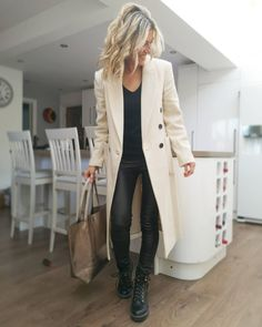 Long coat and tall boots | For more style inspiration visit 40plusstyle.com