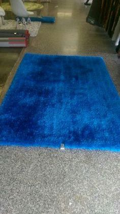 This collection features warm, rich tones in a single Soft Shaggy pattern. Hand-tufted superior high quality for a luxurious look in any living room space. Plush and long lasting durability,easy to clean. http://rugaddiction.com/collections/all-solid/products/solid-electric-blue