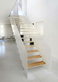 Elegant and simple staircase, with a sculptural white balustrade and wooden treads in the office of Christensen Co. We like the undercut at the base of the balustrade panels. Interior Stairs, Interior Exterior, Interior Architecture, Steel Stairs, Making Space, Modern Stairs, Open Trap, House Stairs, Stair Railing