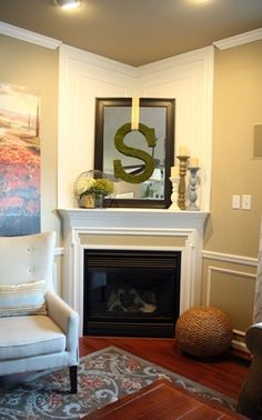 Thrifty Decor Chick corner fireplace makeover- Like the simplicity of mouldings for a straight wall fp as well.