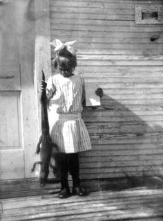 Little cousin Nell just couldn't understand why none of the kids wanted to sit by her when she showed up at the school house with her pet for Show and Tell. (Ft. Lauderdale, early 1900s. Florida Memory Collection)