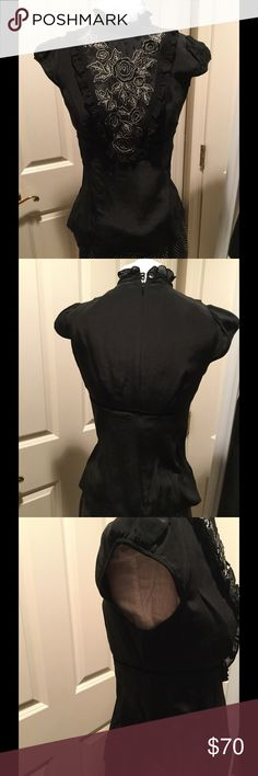 🎀Nanette Lepore Silk Blouse w/embellishments🎀 Exquisite Nanette Lepore silk blouse with sheer bib and gorgeous eyes detailing and black sequins . Size 6. Hidden full zippered back. Velvet trim at upper waist. This blouse matches the suit in picture 8 and would like to sell as a set. Please see the suit listed in closed. Worn once and no defects. Smoke free closet . Price firm for this gem! Black with cream detail threading. Nanette Lepore Tops Blouses