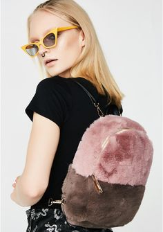 Inconsiderate Fuzzy Backpack cuz you're all about yourself. This two-tone faux fur backpack has vegan leather adjustable straps and a zip closure.