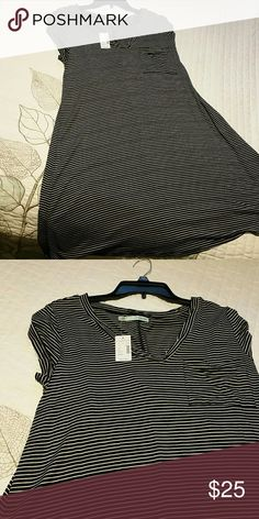 Black & white striped short sleeved dress NWT. Maurices brand short sleeved dress. Has one small breast pocket. Just too big for me. Maurices Dresses