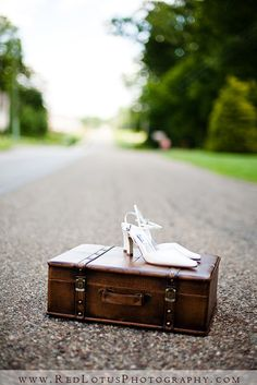 Love the idea of using a prop that ties into your wedding theme for some clever photos.