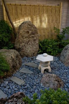 flowing river rocks and lantern - Brown Garden Design