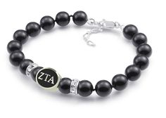 "Zeta Tau Alpha Sorority Sterling Silver & Black Glass Bracelet. Officially Licensed - Made in the U.S.A. Solid Sterling Silver - Not Plated. 8mm Swarovski Glass Pearls. 7.25"" Long with a 1"" Extender. Ships in 3 to 5 Business Days."
