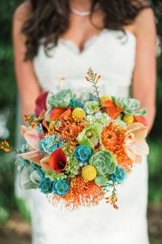So pretty for a wedding bouquet. Love the unexpected color combo of the aqua/rust/yellow/orangey tones. Photography by melissabrandman.com/, Floral Design by floralworksandevents.com/
